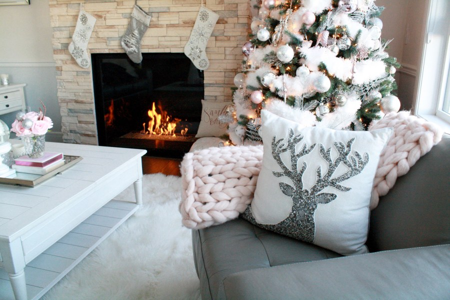 These glamorous Christmas pillows add a pop of fun to this holiday living room