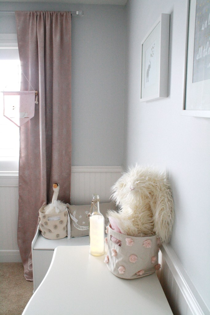 Pink and gray nursery with shimmering pink drapes