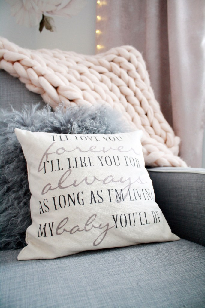 Pink and gray nursery with 'I'll love you forever' pillow