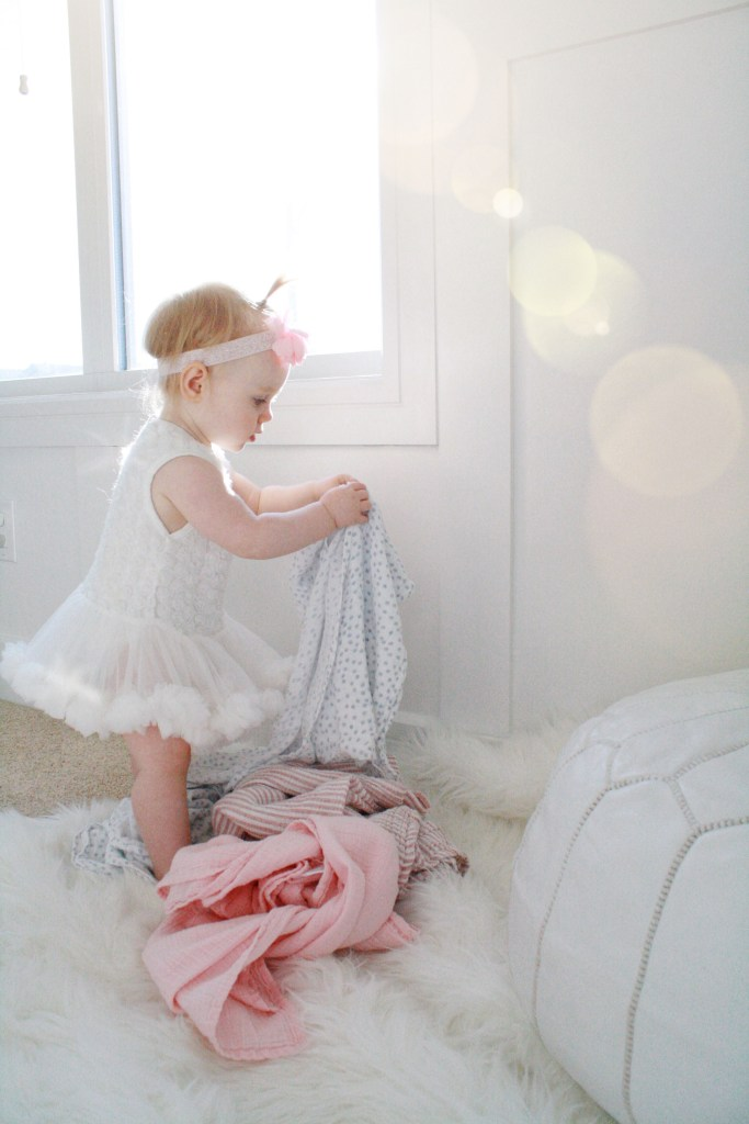 Baby girl playing with swaddle blankets - 10 Favourite Baby Items - Baby shower gift ideas - Baby Christmas gift ideas - Best baby items on Chandeliers and Champagne