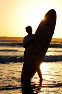 Surfer at sunset in Bali