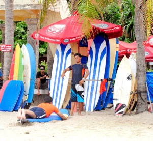 A beginner surf lesson in Legian Bali, learning how to lie on the surf board