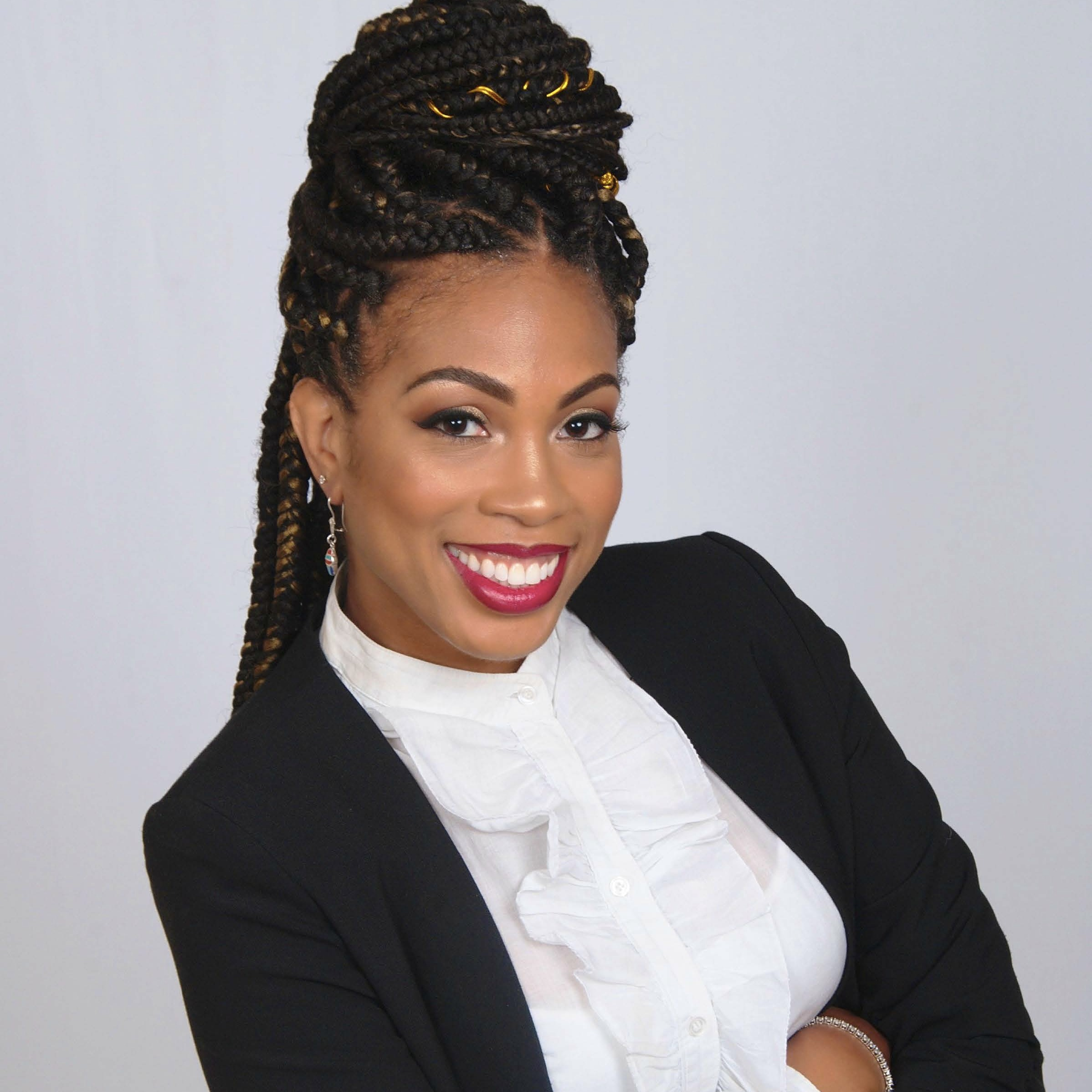 Ayana Jordan, a Black woman with long braided black hair and white blouse