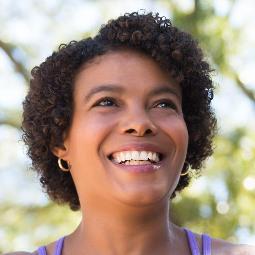 Terri Givens, a Black woman with short curly hair and purple top