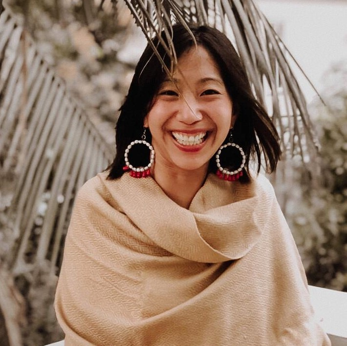 Headshot of Tiffany Yu, an Asian woman with brown hair and a beige shawl