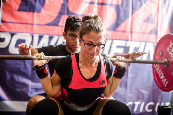 Kim Cofino squatting