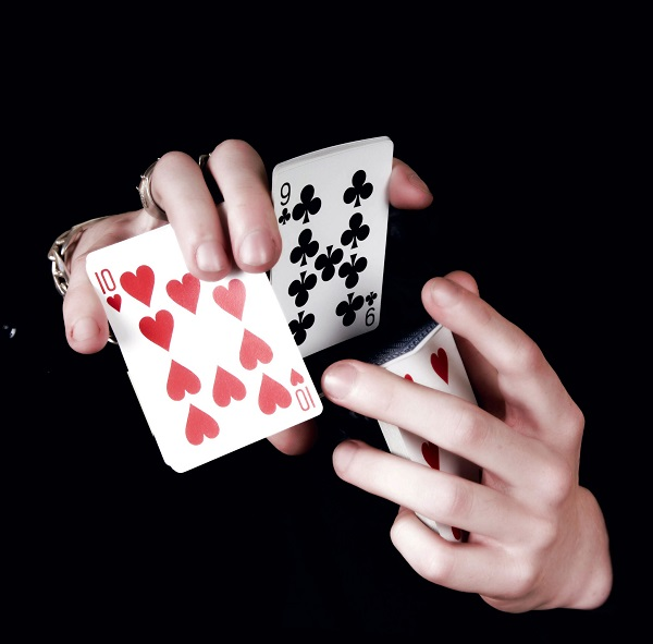 2 hands shuffling card deck for magic trick