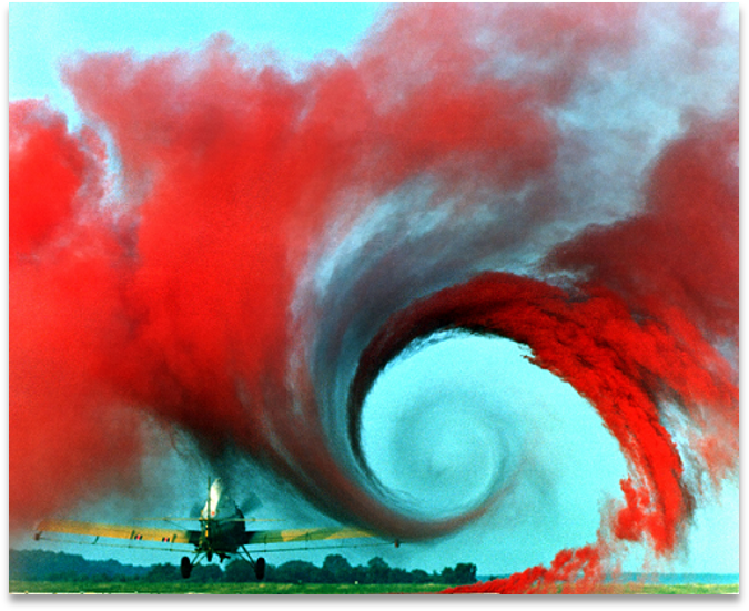Red dye showing the air turbulence of a landing airplane