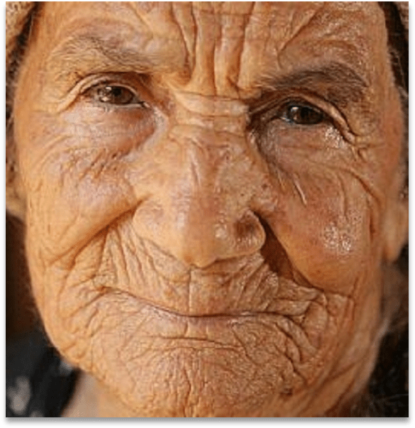 Portrait photo of the face of an old woman