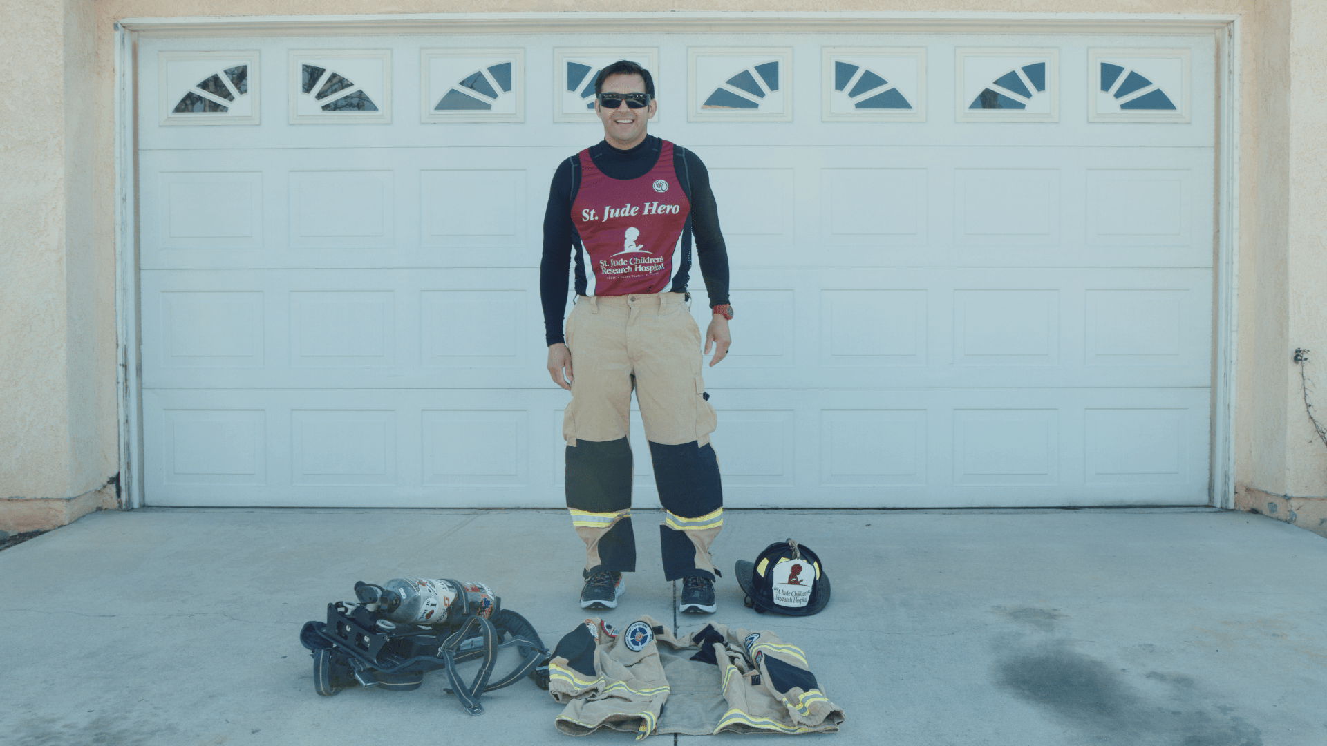 Jose Zambrano demonstrating his firefighter gear.