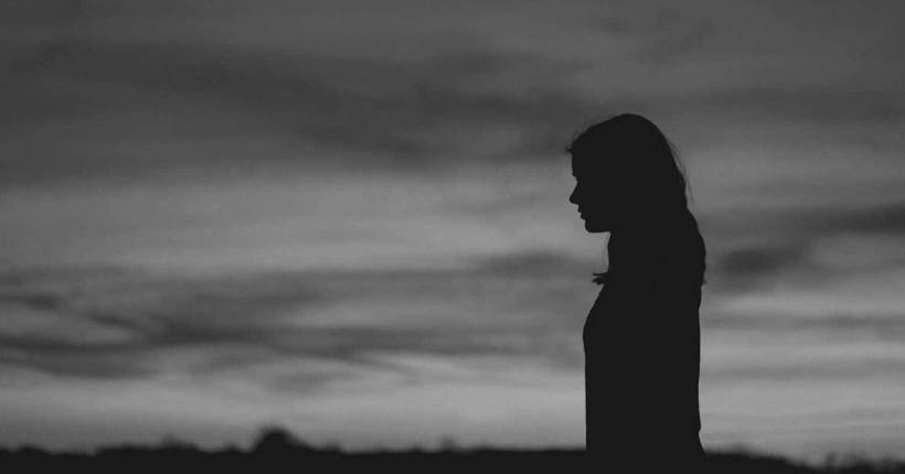 Silhouette of woman thinking (black & white)
