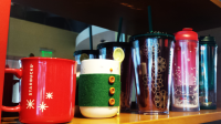 The snow man mug... has a tiny green sweater. Come on. ♥