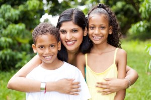 happy latin mother and kids outdoors