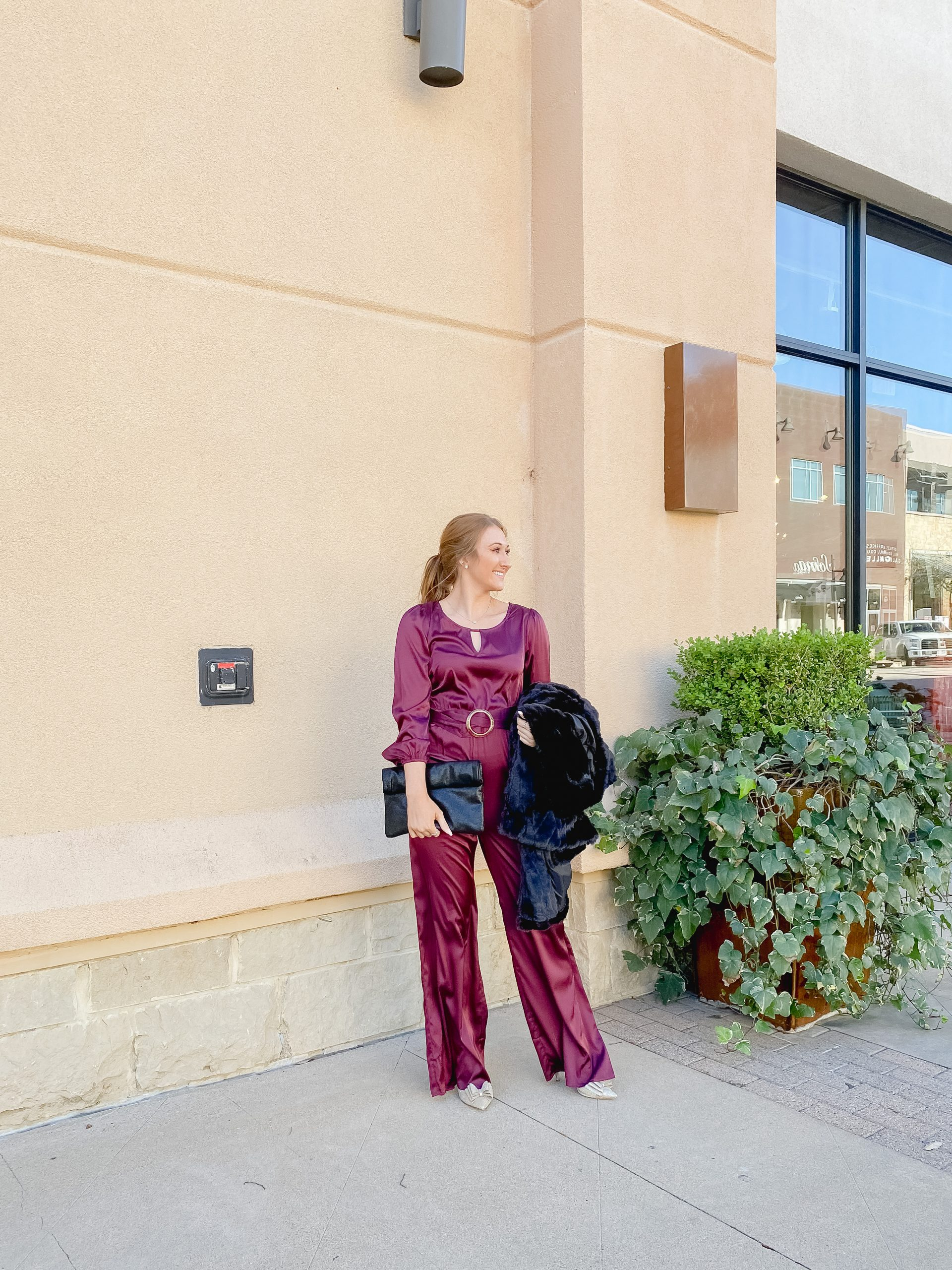 Satin jumpsuit from Red Dress Boutique and black clutch - outfit for the holidays \\ outfit for NYE