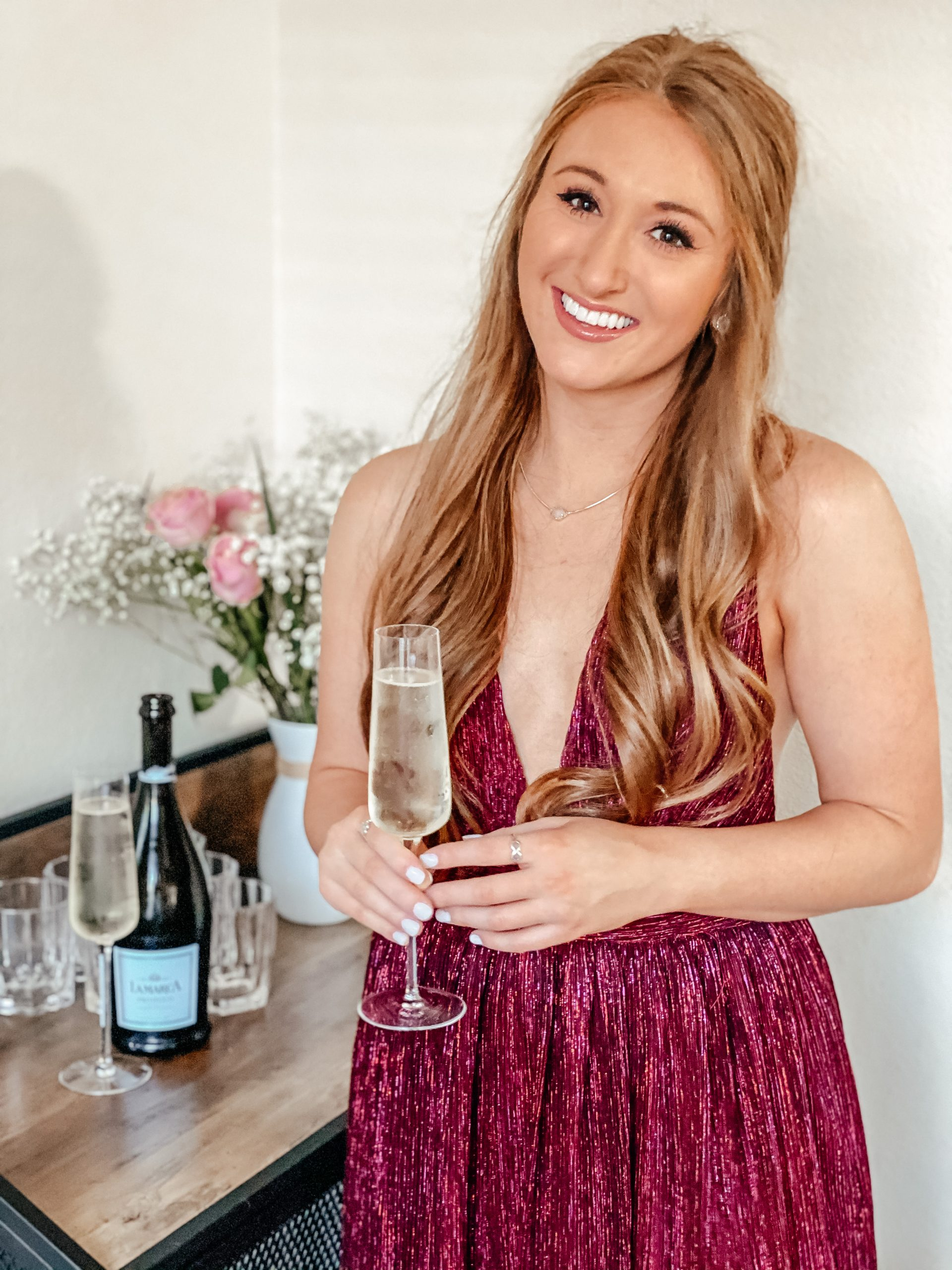 Pouring champagne prosecco for Valentine's Day and wearing a dress for Valentine's Day from Nordstrom