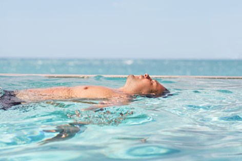 Man relaxing in the swimming pool