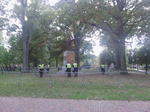 Police form a barrier around the statue.