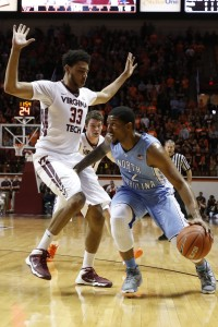 McDonald dribbles around a VT defender (Todd Melet)