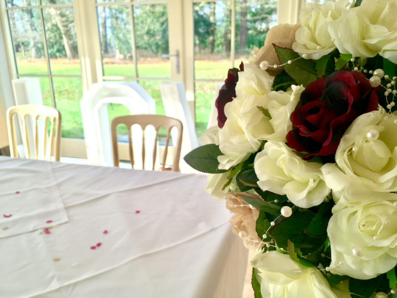 Flowers at the top of the aisle at Kelham House Country Manor Hotel.