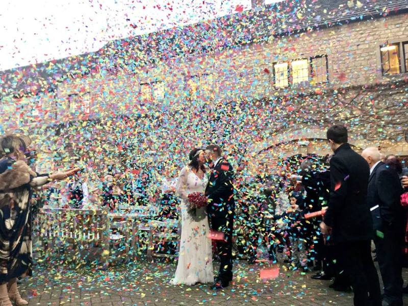 Confetti and a kiss at a Wedding between Christmas and New Year.