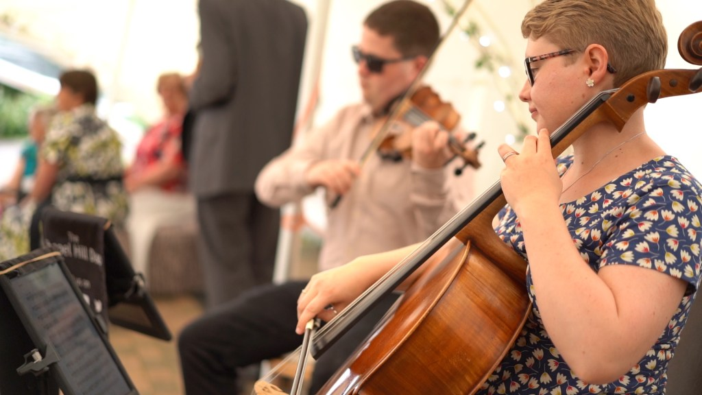 Violinist Jaya Hanley and Cellist Sarah James perform at a wedding drinks reception.