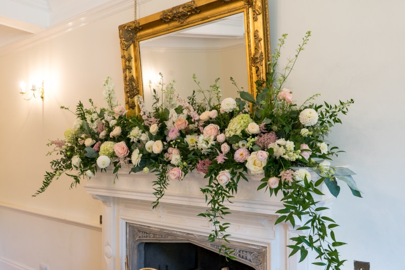 A floral display in the ceremony room at Lanwades Hall.