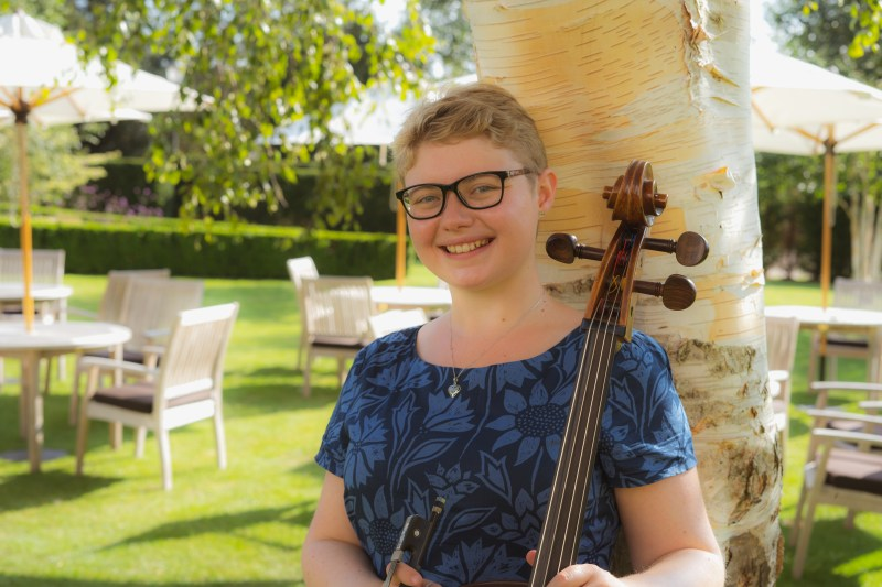 Sarah James Cellist in the gardens at the Bedford lodge hotel near Newmarket.