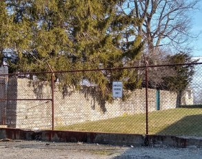 The stone wall that stands near the Mitchell home and came from the basement of the McClain mansion.