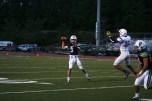 Quarterback Beau Lark (3) sends the ball hurling towards the running back.