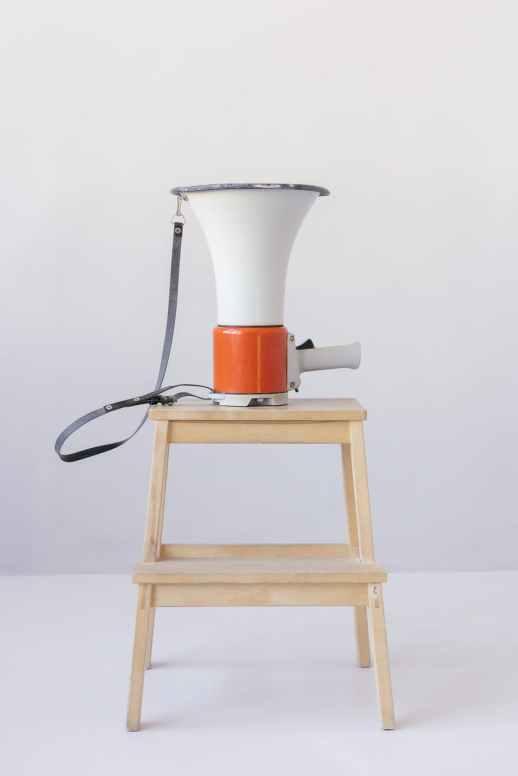 loudspeaker on top of wooden stool