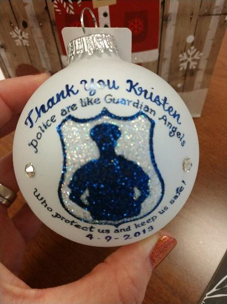 While on duty in 2013, Officer Lewis saved a woman's life who was in an auto accident. The woman gave her this Christmas ornament just before holiday break. Courtesy Photo.