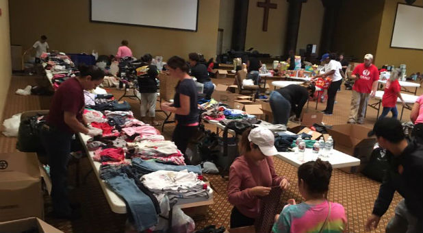 Volunteers sort through donations at Grace Woodlands.