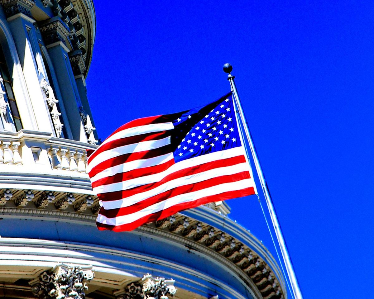 """Detail: """"Old Glory"""" flying on the U.S. Capitol."""