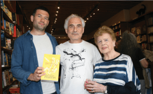 Charles Harris flanked by his son, Oliver, and his mother, Pamela at his novel's launch at West End Lane Books in Hampstead