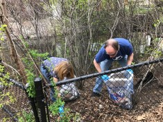 Collecting trash along the Muddy River
