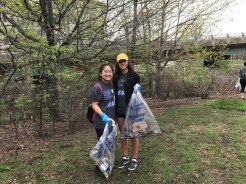 Collecting trash along the Charlesgate park Muddy River