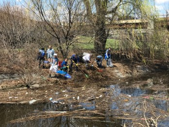 Picking up trash along the Muddy River