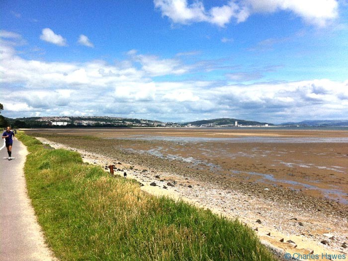Swansea Bay viewed from near the Mumbles on the Wales Coast Path. Photograph by Charles Hawes. Walking in Wales.