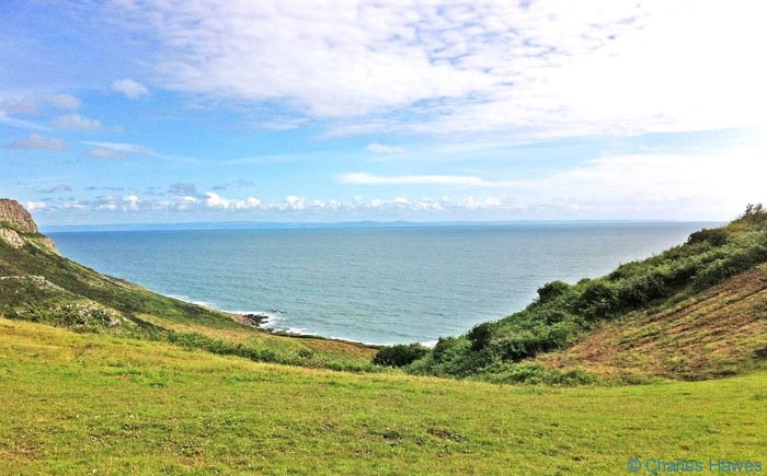 View to the sea from near Three Cliffs on the wales Coast path, photographed by Charles Hawes. Walking in Wales..