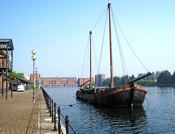 Eben Haezer sailing barge on Atlantic Wharf in Cardiff. Photographed from the wales Coast Path by Charles Hawes. Walking in Wales.