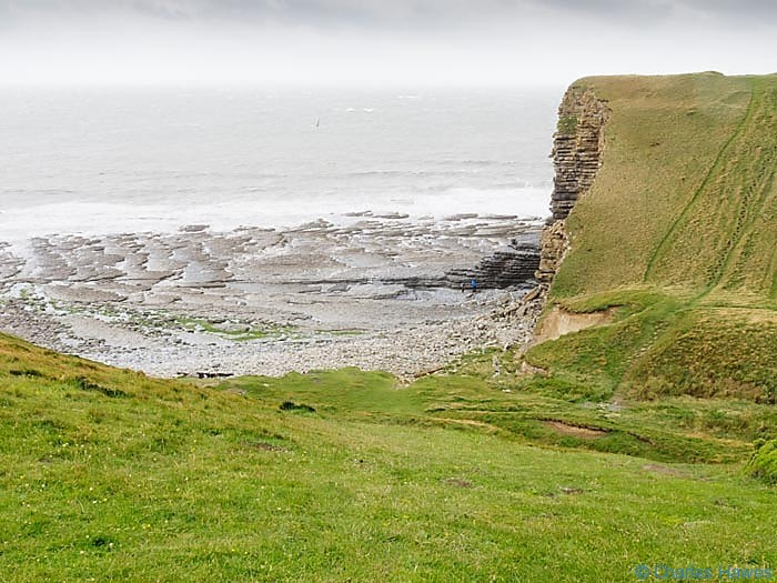 View to the cliff and beach at Nash Point from the wales Coast path, photographed by Charles hawes. Walking in Wales.