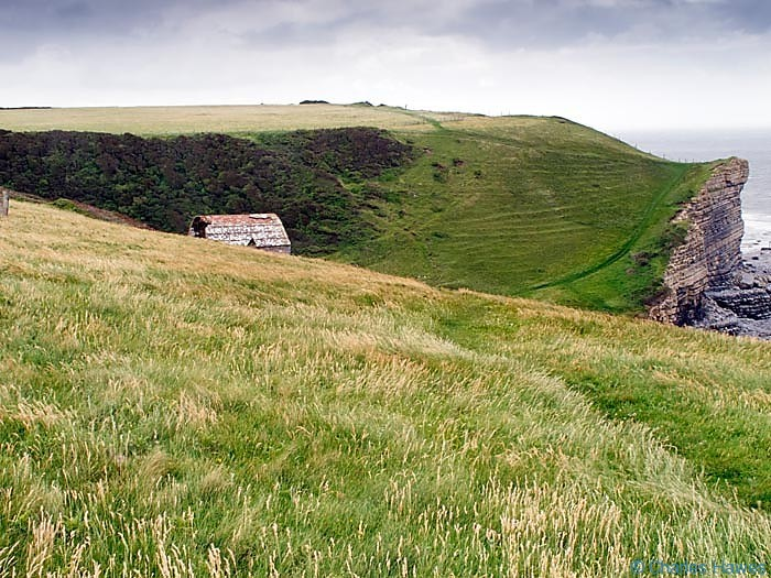 Cwm nash viewed from The wales Coast path and photographed by Charles Hawes. Walking in Wales.