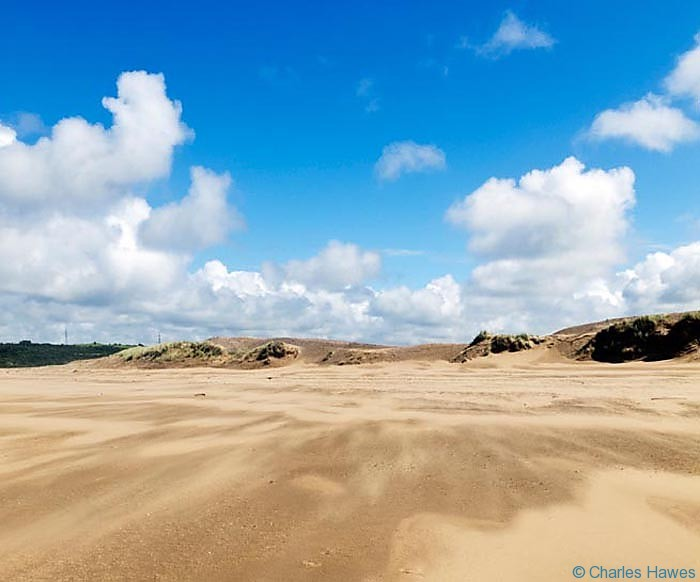 The far end of Aberavon sands near the River Neath photographed from the Wales Coast Path by Charles Hawes. Walking in Wales.