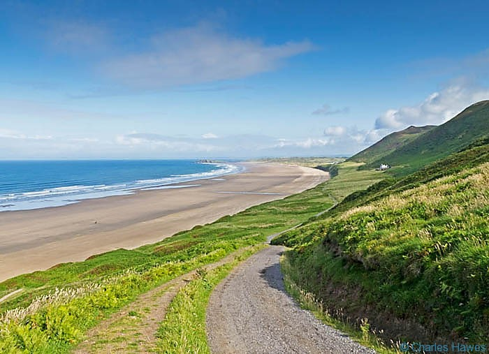 Rhossili Bay taken from the wales Coast Path above Rhossili Bay between Rhossili and Llanrhidian on the Wales Coast Path, photographed by Charles Hawes. Walking in Wales.