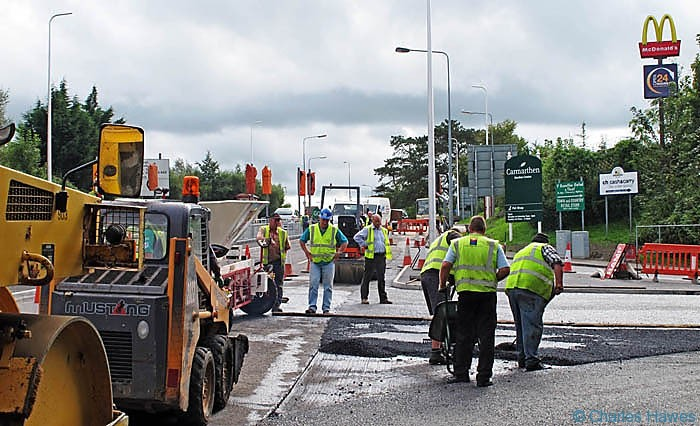 Roadworks on the outskirts of Carmarthen on the Wales Coast Path photographed by Charles Hawes. Walking in Wales.