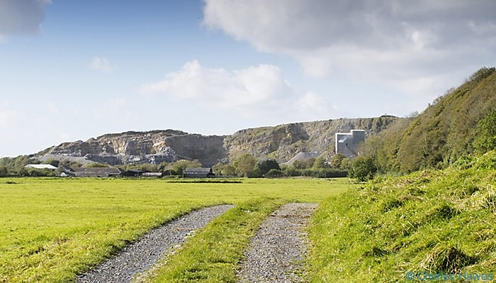 Coygen quarry photographed from the Wales Coast Path between St Clears and Amroth by Charles Hawes. Walking in Wales.