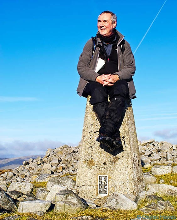 Charles Hawes on the Trig Point of Twr Pen-cyrn, Powys,  photographed by Paul Steer