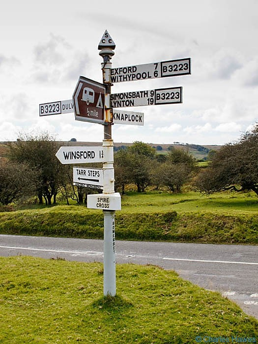 Signpost at Spire Cross on the B3223 near Winsford, Exmoor, Somerset, photographed by Charles Hawes. Walking in Exmoor.