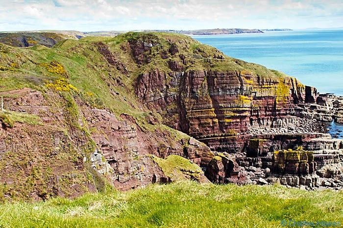 Dramatic rock strata in Red Sandstone of Trewent Point in Pembrokeshire on the wales Coast path, photographed by Charles Hawes