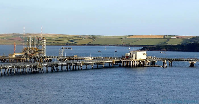 Oil piplelines and jetties in Milford Haven, Pembrokeshire, photographed from The wales Coiast path by Charles Hawes